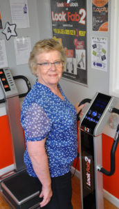 Wendy from Lesley Shand Funeral Service trying out one of the Good Vibration machines that will be at the 50-plus information day