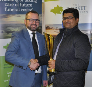 Performance of the season award went to Abbotsbury's Krishnan Subramanian for taking 9 for 12. Shane Watson (left) is from the sponsors, The Dorset Funeral Plan.
