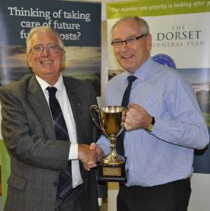 Peter Douch from the sponsors, The Dorset Funeral Plan, with Pete Tucker from Charlton Down - the team of the year.
