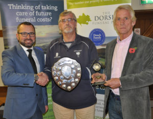 Shane Watson (left) from the sponsors, The Dorset Funeral Plan, with Richard Langford and Buddy Langford, the Div 2 winners .