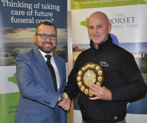 Shane Watson (left) from the sponsors, the Dorset Funeral Plan, with Anthony Mercer from Chalke Valley CC, Div 5 winners