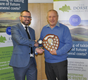 Shane Watson (left) from the sponsors, the Dorset Funeral Plan, with Chris Ralph from Marnhill CC, Division 6 winners.