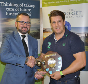 Shane Watson (left) from the sponsors, the Dorset Funeral Plan, with David Coy, of Cranborne CC, Div 3 winners