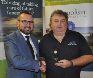 Shane Watson (left) from the sponsors, the Dorset Funeral Plan, with Stuart Peters of Hamworthy Rec II, Div 4 runners-up