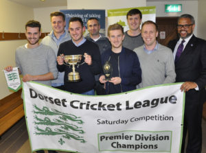 Wimborne CC - Premier League champions! Nick Douch (far right) from the sponsors, The Dorset Funeral Plan, with (l-r) Lewis Naylor, Frank Torrill, james Miller, Colin Randall, Simon Woodruff, George Bartlett and Graham Cole.