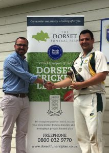 Shane Watson from the sponsor, The Dorset Funeral Plan, presents Bere Regis CC skipper with the team of the Month trophy
