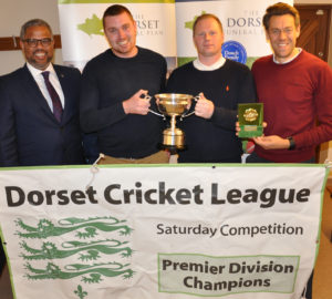 Nick Douch, left, from the Dorset Funeral Plan and Premier League champs Broadstone I. (l-r) Steve trembath, Ashley Collison, Mike Holm