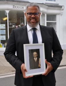 Nick Douch of historic business F C Douch with a photo of his great grandfather Frederick Charles Douch