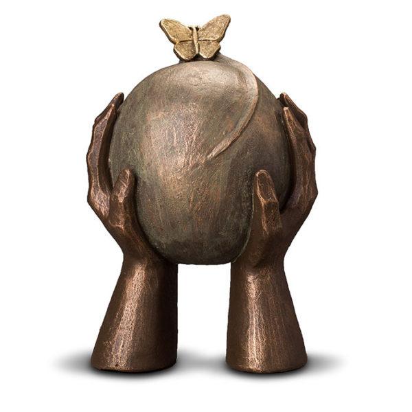 geert-kunen-designer-urn-butterfly-sphere-in-hands-ceramic-bronze-urn